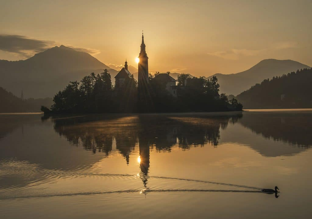 Lake Bled in Slovenia. Watching sunrise here is a must for the Europe Bucket List.