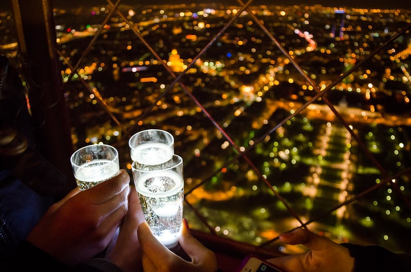 Having champagne together on the Eiffel Tower is one of the best ideas on the bucket list for couples.
