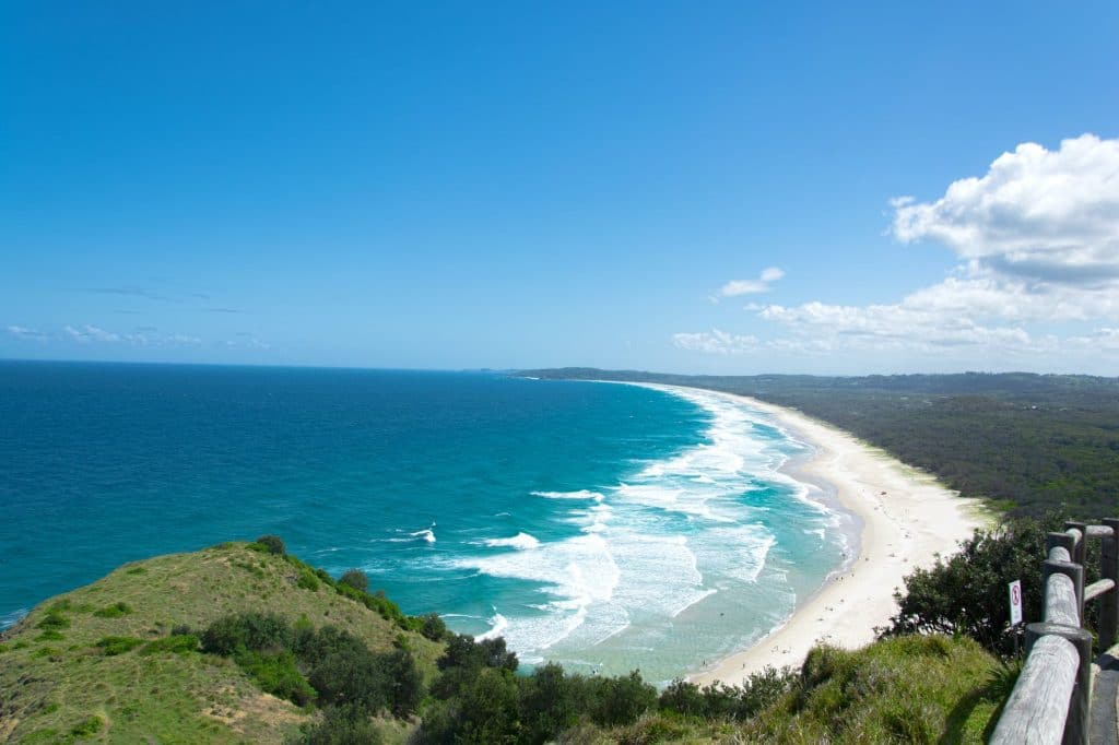 Walk barefoot in Byron Bay – catch the Aussie vibes.