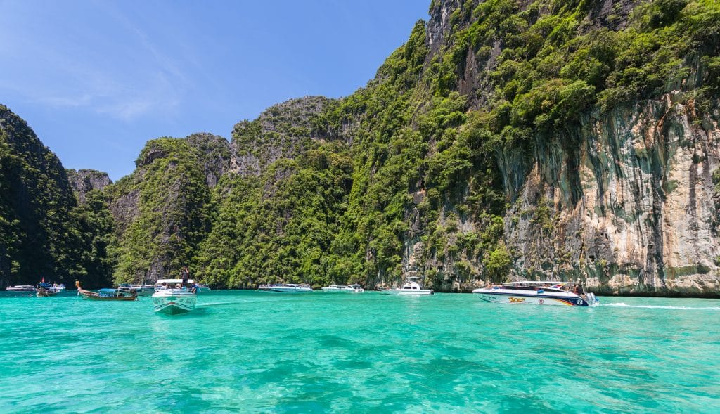 Cross island hoping off your Thailand Bucket List with a visit to Phi Phi Island.