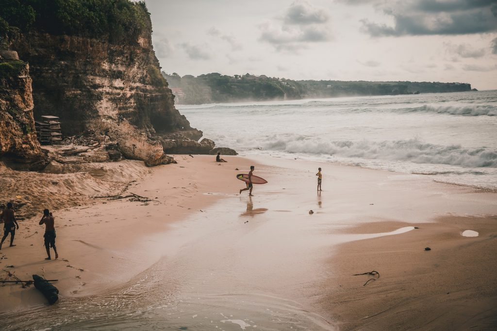 You have to ride the waves at Uluwatu.